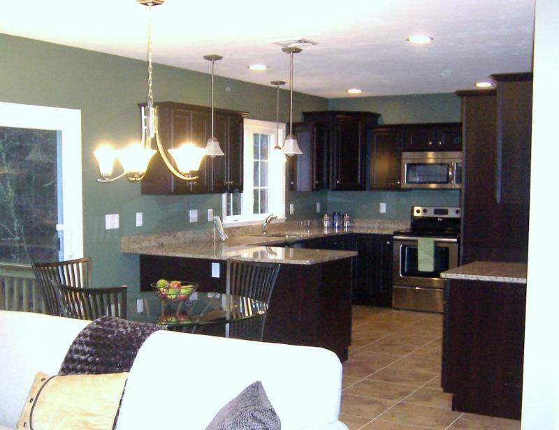 The beautful chocolate brown cabinets are so  in  The granite