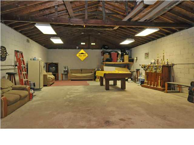 Want a home with a huge garage and large lot in louisville for How big is two car garage