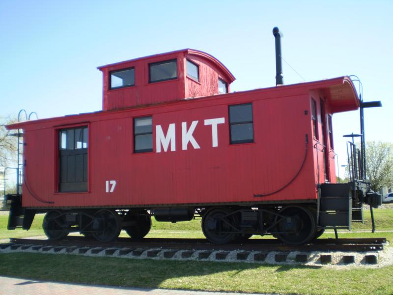Old red train cabosee in Katy TX