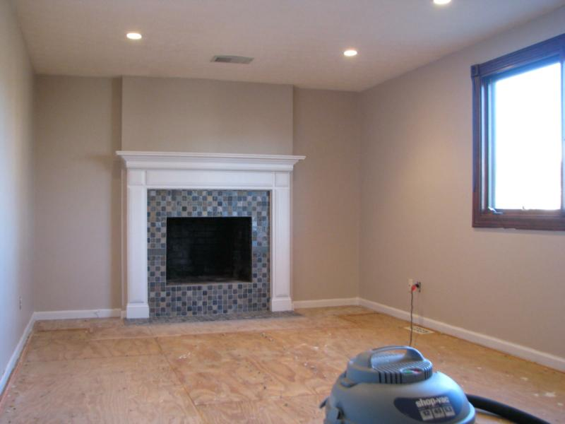 Before and after fireplace photos add space and value to - How to cover brick fireplace ...