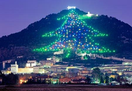 the worlds largest christmas tree display rises up the slopes of monte ingino outside of gubbio in italys umbria region composed of about 500 lights - Largest Christmas Store