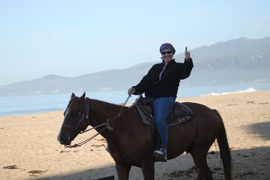 riding horse on beach