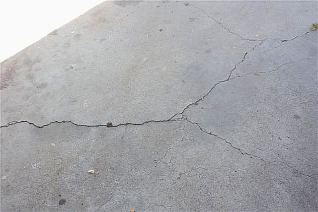 how to fix cracks in concrete driveway
