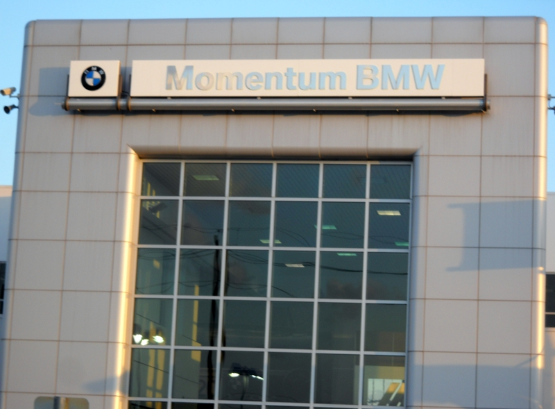 Front of Momentum BMW with BMW decal