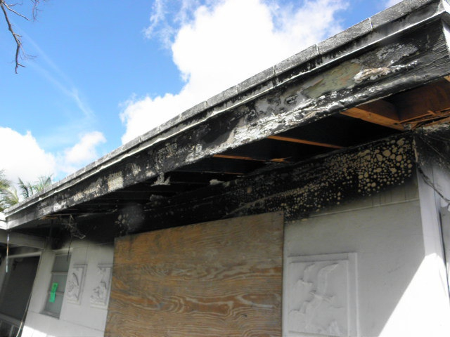 Fire damage from electrical panel Florida Home Inspection Team