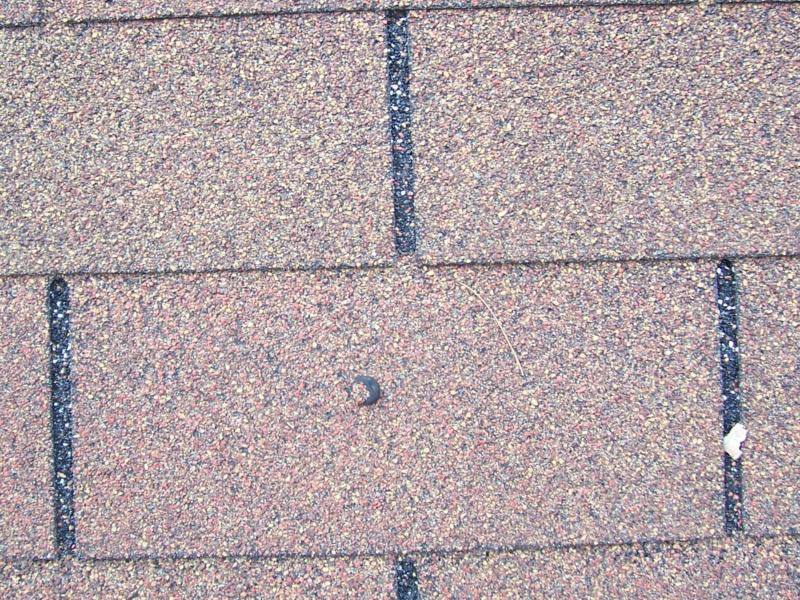 Roofing Nail Popped Up Through Shingle