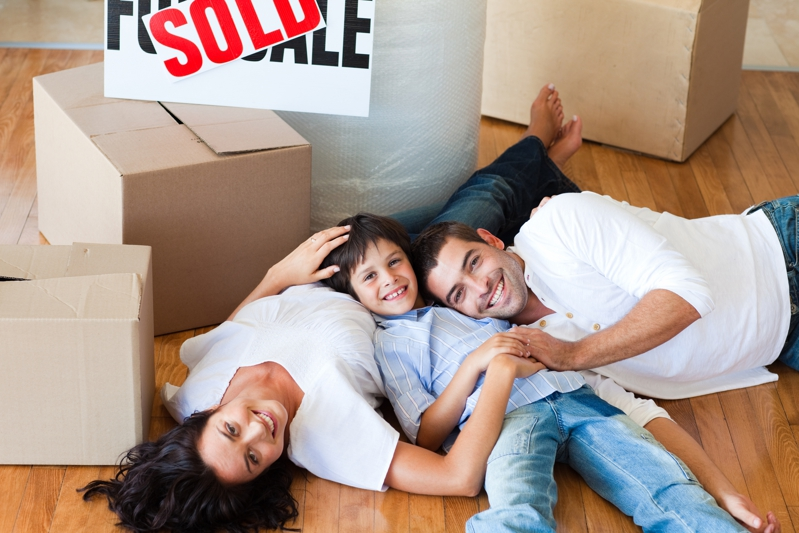 Happy Family in Their Sold House