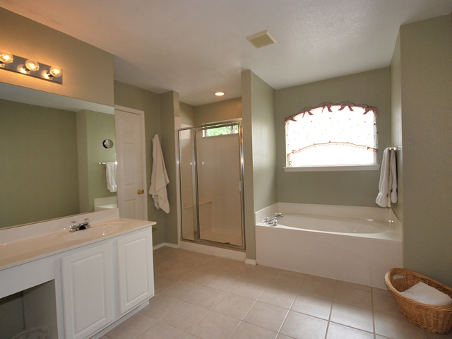 Master bath has garden tub, separate shower