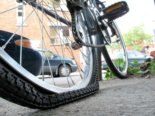 Flat tire needs air in Maple Ridge real estate