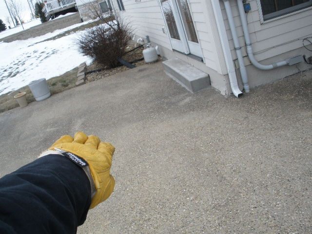 Iowa home Inspection reveals negative slope on patio