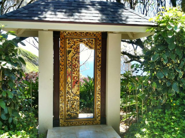 decorated gates to garden path in Heulo Maui, oceanfront homes for sale