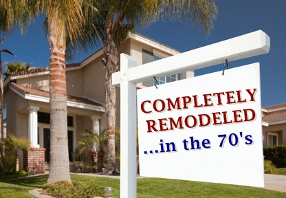 "Real estate sales sign in front of a house, which reads ""completely remodeled... in the 70's"""