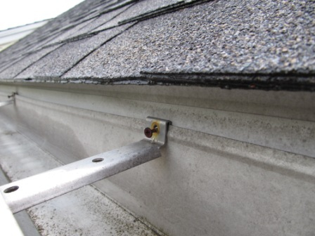 Dry wall screw fastening a gutter