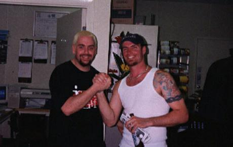 Matt with bad blonde hair hanging with Vanilla Ice backstage.