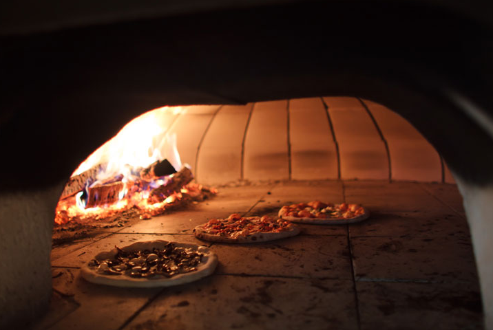 pizzas in the copper oven