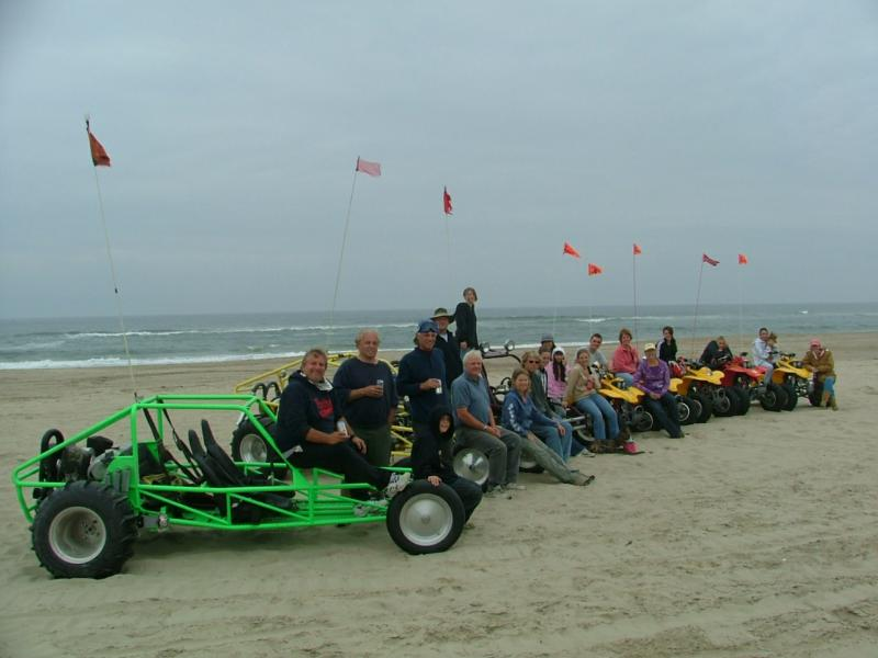Sandrails and quads lined up on the Florence Oregon beach