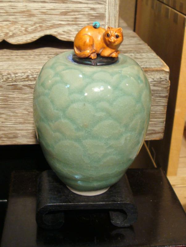 Celadon porcelain with cat on top