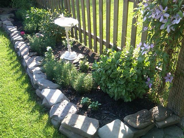 picket fence, bird bath and flowers