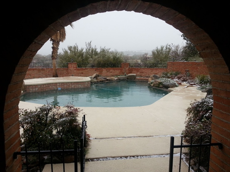 Snowfall over the pool view Tucson Foothills