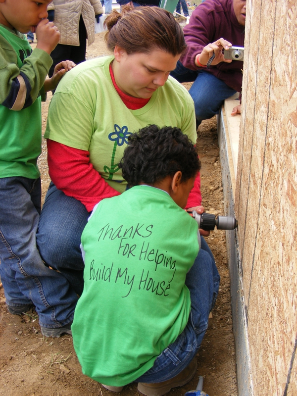 Laura Blevins and son setting the 1st wall