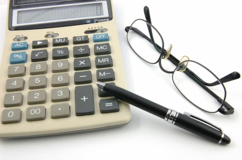 Calculator with glasses and pen
