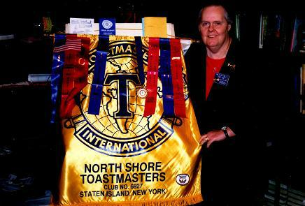 Fran holding North Shore Club Banner