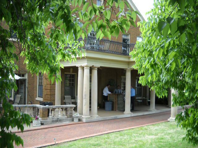 Stately trees surround the porte-cochere at the Kennedy Mansion Bed & Breakfast