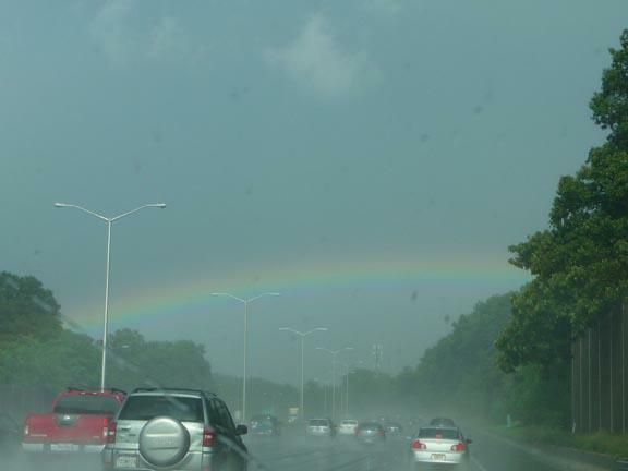 Rainbow over highway