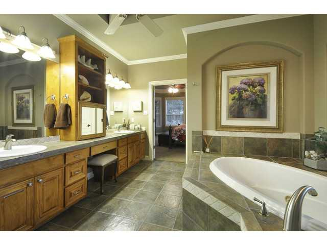 The master's bathroom has double vanity, jetted tub.