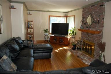 living room with hard wood florrs and brick fireplace Mayflower Village Monrovia CA