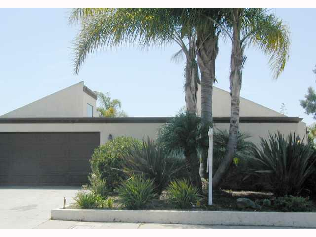 front of duplex with palm tree