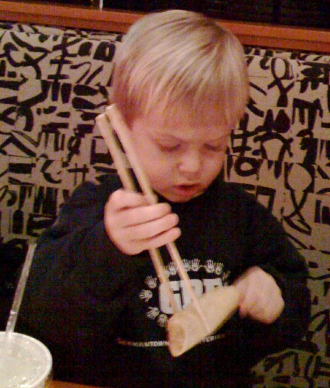 3 Year old with chopsticks!