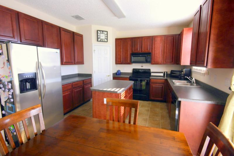 beautiful kitchen with dark 42  cabinets, pantry, food preparation