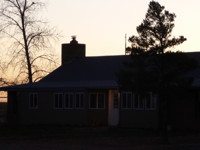 house at sunset on the ranch