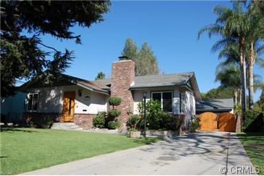 single story home with beautiful lawn and pine tree in Mayflower Village Monrovia CA