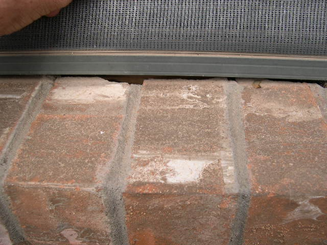 Window sill with large gaps.