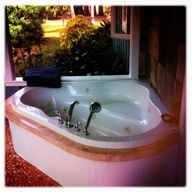 outdoor bathtub in a Haiku Maui HI home for sale