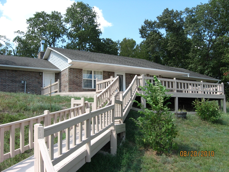 UNDER CONTRACT CUSTOM BUILT HOME ON A HILL OVERLOOKING