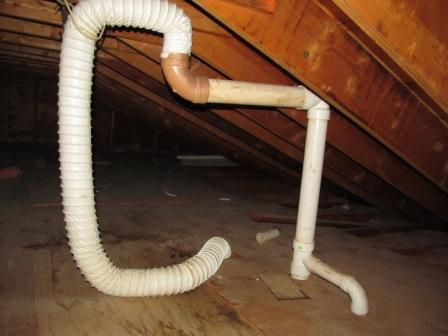Bathroom vent piped into plumbing vent