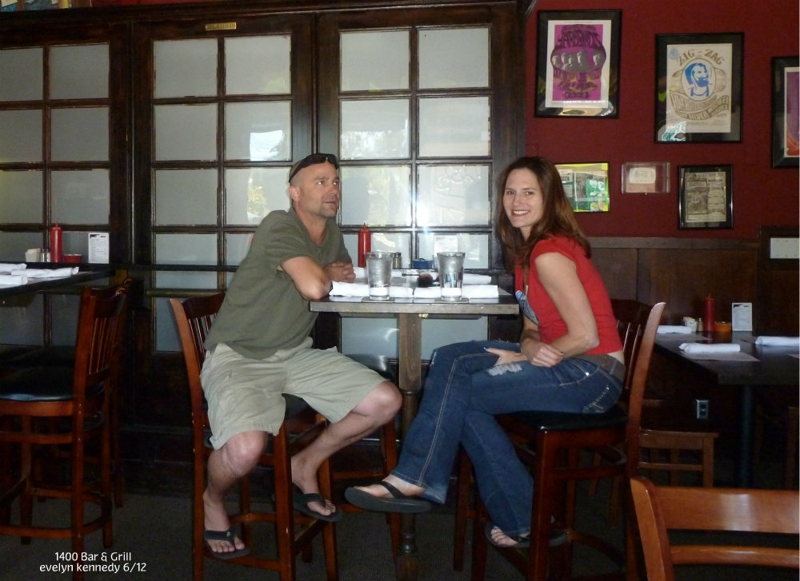 couple enjoying food at 1400 Bar & Grill