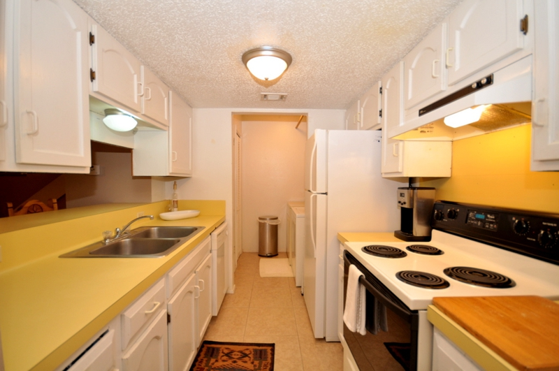 A san marcos texas duplex for sale near texas state for Galley kitchen with dining area