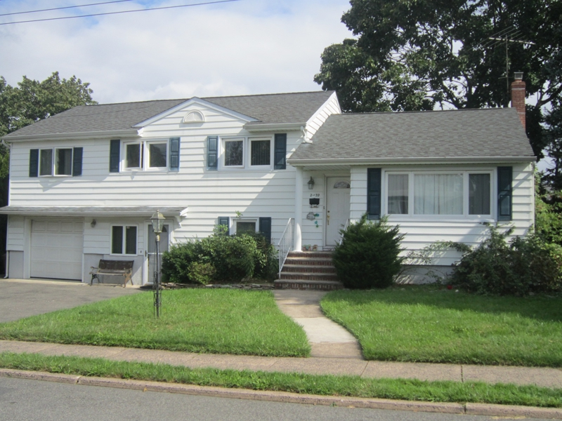Expanded split level house for sale in fair lawn for 3 level homes