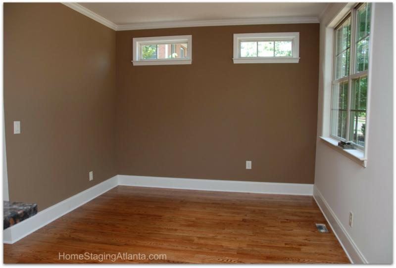 Living room before being professionally staged by home staging Atlanta