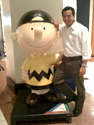 Anthony Ebright with Charlie Brown statue