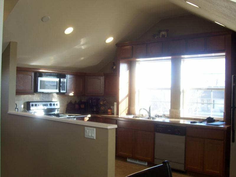 awesome suite above garage. Behind the detached garage apartment there is a large flsgstone patio with  an Arbor are 2 ponds that connected by waterfall Ranch Style Home Delta Colorado Awesome Place