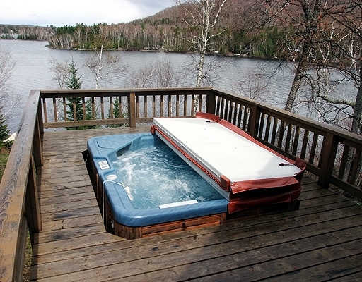 Sliding into a hot tub on the maine lake home deck life for Deck gets too hot