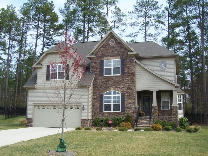 ... Stacked stone front on this Grandale home in Durham, NC