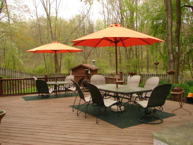 Deck with patio furniture, wooded lot