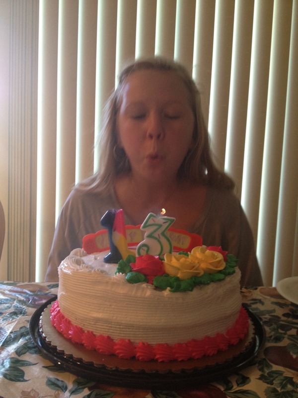 Skyler blowing out the candles