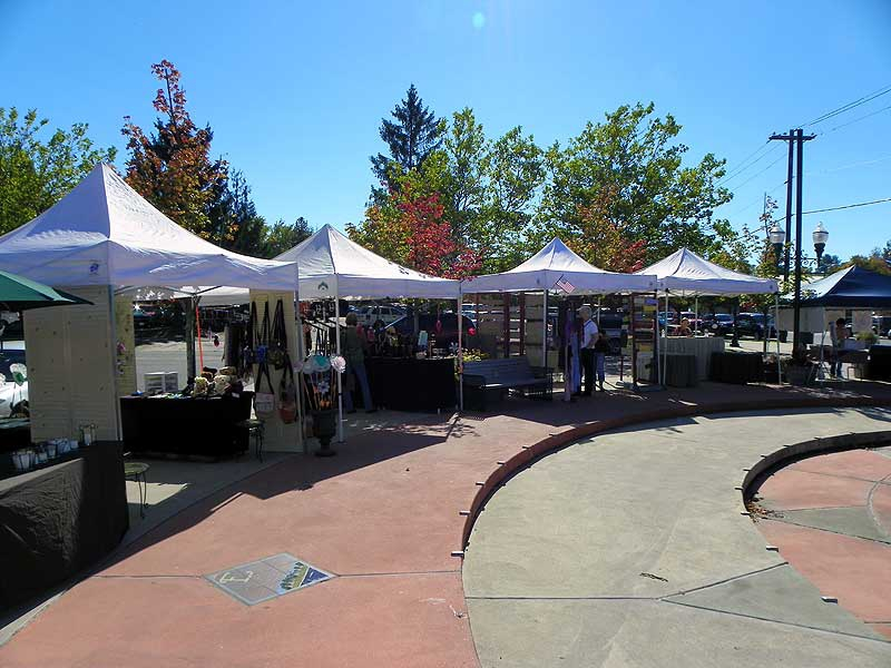 The booths around the fountain at the Sandpoint Farmer's Market